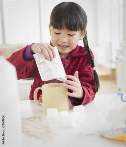 Chinese girl making hot chocolate