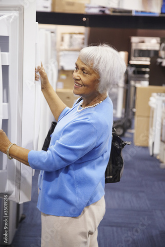 Senior African American woman shopping for appliances