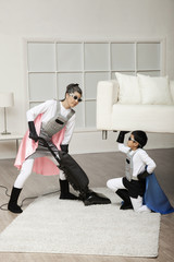 Korean superhero son lifting sofa for mother to vacuum underneath