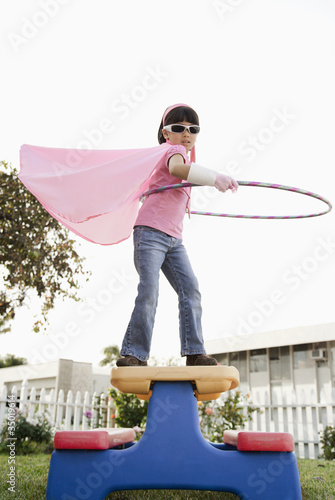 Korean girl in superhero costume and hula hoop