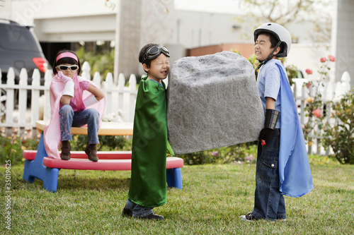 Korean children as superheros carrying large boulder