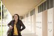 Student standing in school corridor