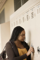 Student opening school locker