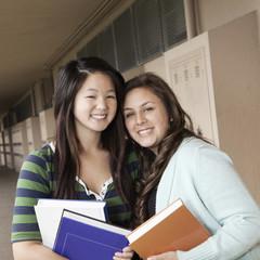 Students hugging in school corridor