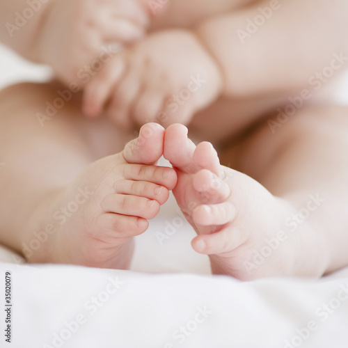 Mixed race baby boyÕs toes