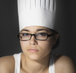 Hispanic woman in chefÕs hat and eyeglasses