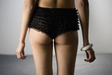 Lacy underwear on mixed race womanÕs buttocks