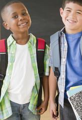 Smiling boys wearing backpacks