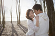 Korean couple hugging outdoors