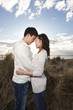 Korean couple hugging on beach