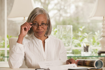 Black woman adjusting eyeglasses
