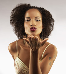 Glamorous African American woman blowing kisses