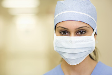 Close up of Asian surgeon in surgical cap and mask
