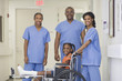 Doctors standing with girl with broken leg