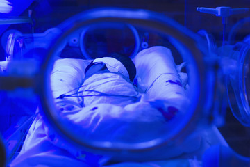 Hispanic baby in intensive care unit