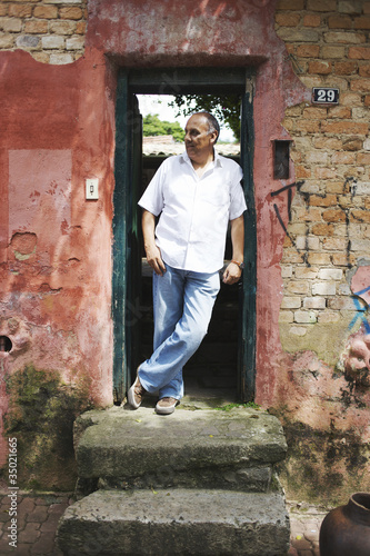 Hispanic man standing in doorway
