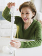 Japanese woman replacing energy efficient light bulb