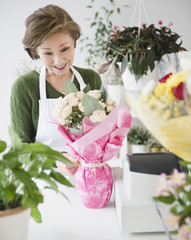 Japanese florist wrapping flower bouquet