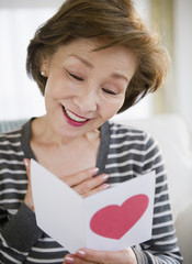 Japanese woman reading valentine card