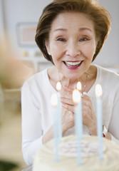 Japanese woman admiring birthday cake