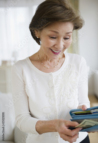 Japanese woman removing money from wallet