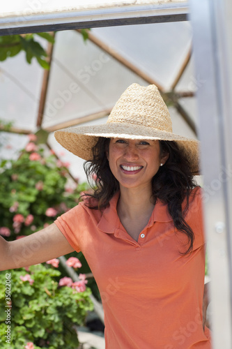 Ecuadorian woman in doorway of greenhouse