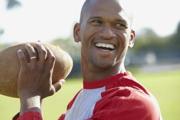 African American man throwing football