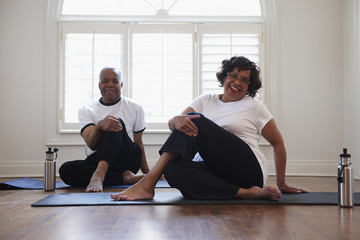 Black couple stretching together