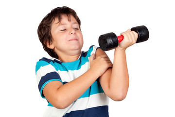 Funny child playing sports with weights