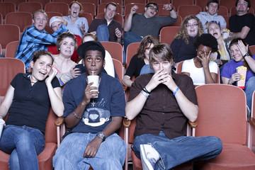 Friends watching movie in theater