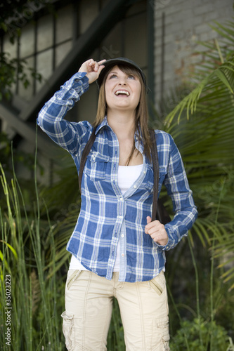 Smiling Caucasian teenager looking up