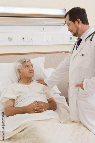 Doctor talking with patient in hospital room