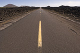 Highway through barren landscape