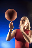 Caucasian woman spinning basketball