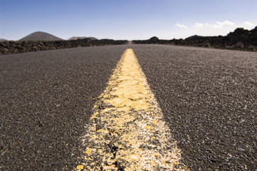 Highway through barren landscape