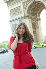 Caucasian woman standing near Arc de Triomphe