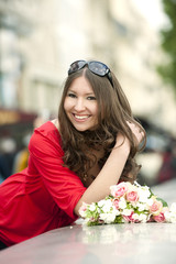 Smiling Caucasian woman holding bouquet
