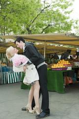 Romantic Caucasian couple at market