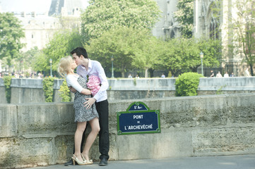 Caucasian couple kissing on Pont de L'Archeveche