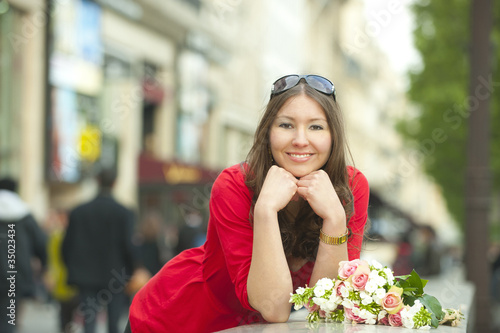 Smiling Caucasian woman with bouquet