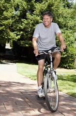 Caucasian man riding bicycle