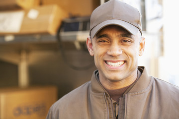 Smiling Hispanic delivery man