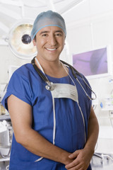 Hispanic surgeon in operating room
