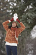 Chinese woman holding small snowman