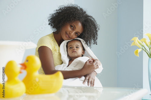 Mother drying baby off with towel