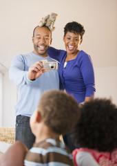Black parents photographing children