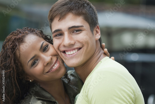 Smiling couple hugging
