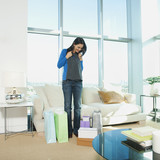 Mixed race woman looking at clothing in living room