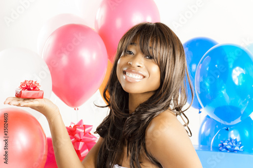 African American woman with birthday presents