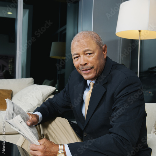 Black businessman reading newspaper